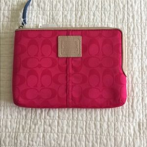 NWT Coach fuchsia tablet case.